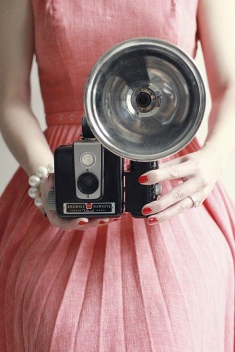Retro Coral Bridesmaids Dress with a Vintage Camera | Preppy in Poppy https://heyweddinglady.com/preppy-in-poppy-seaside-summer-wedding-inspiration/