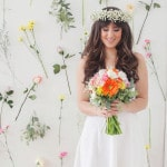 Sweet Sixties Styled Bride with A Flower Wall Backdrop | Studio Amy Luna Photography | See More! https://heyweddinglady.com/peace-and-love-the-sweetest-60s-styled-shoot-ever/
