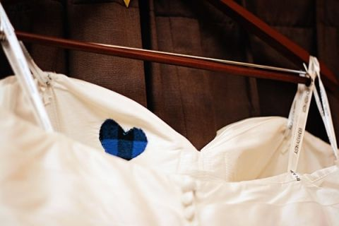 A Heart from the Father of the Brides Flannel Shirt for her Something Blue | May Gunsul Photography | See More! https://heyweddinglady.com/fairy-tale-wedding-in-a-snowy-mountain-lodge-from-may-gunsul-photography/