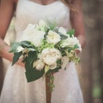 Lush Green and White Bridal Bouquet trailing Velvet Ribbons | Bonnallie Brodeur Photography | See More! https://heyweddinglady.com/handmade-bohemian-woodland-wedding-from-bonnallie-brodeur-photography/