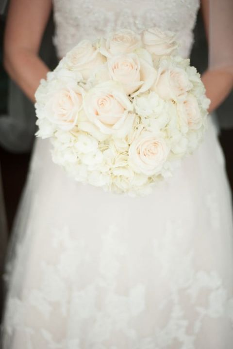 Lush Ivory Bridal Bouquet | Captured by Belinda | See more! http://heyweddinglady.com/ethereal-beach-wedding-after-the-storm-from-captured-by-belinda/