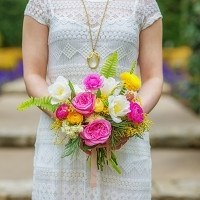 Bright Pink and Yellow Bridal Bouquet by Bows and Arrows | Andrea Elizabeth Photography | See More! https://heyweddinglady.com/bright-pink-and-yellow-boho-bride-shoot-at-the-dallas-arboretum/