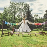 A Handmade Wedding Tipi with DIY Banners for a Bohemian Woodland Ceremony | Bonnallie Brodeur Photography | See More! https://heyweddinglady.com/handmade-bohemian-woodland-wedding-from-bonnallie-brodeur-photography/