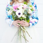 A Blue Floral Printed Blazer with a White Tulle Skirt for Gorgeous Engagement Portraits | Sounds Like Yellow Photography | See More! http://heyweddinglady.com/glitter-and-peonies-and-cupcakes-oh-my-a-bake-shoppe-engagement-from-sounds-like-yellow-photography/
