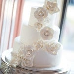 A Gorgeous Glowing White Wedding Cake | Maru Photography | See More! https://heyweddinglady.com/glam-purple-and-green-enchanted-forest-wedding-from-maru-photography/