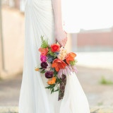 Cayenne, Radiant Orchid, and Gold Spanish Inspired Bridal Bouquet | Charla Storey Photography | See More! http://heyweddinglady.com/colorful-cayenne-radiant-orchid-bohemian-wedding-inspiration-board-inspired-by-napa-valley-linens/