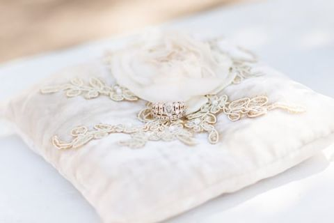 Ivory Lace Wedding Ring Pillow | Dina Remi Studios | See More! http://heyweddinglady.com/peach-and-blush-vintage-shabby-chic-wedding-inspiration-from-dina-remi-studios/