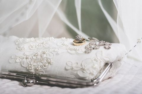 Vintage Lace Clutch and Wedding Jewelry | Brit Jaye Photography | See More! http://heyweddinglady.com/vintage-nautical-wedding-on-a-yacht-from-brit-jaye-photography/