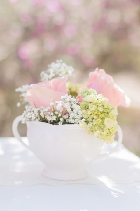 Shabby Chic Teacup Centerpiece | Dina Remi Studios | See More! http://heyweddinglady.com/peach-and-blush-vintage-shabby-chic-wedding-inspiration-from-dina-remi-studios/