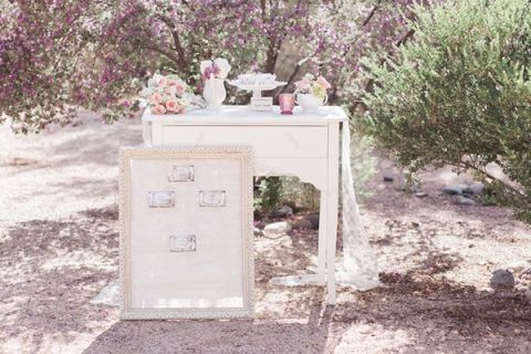 Vintage Escort Card Table with Shabby Chic Decor | Dina Remi Studios | See More! http://heyweddinglady.com/peach-and-blush-vintage-shabby-chic-wedding-inspiration-from-dina-remi-studios/