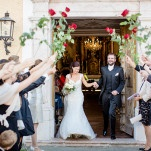 An Arch of Red Roses for the Bride and Groom to walk through | Wedding Memories | See More! https://heyweddinglady.com/alpine-wedding-in-austria-from-wedding-memories/