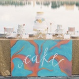 Vibrant Watercolor Wedding Cake Table in Glittering Gold, Aqua, and Burnt Orange | Kat Braman Photography | See More! http://heyweddinglady.com/modern-art-nouveau-wedding-inspiration-glittering-gold-orange-blue/