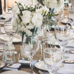 Fresh White and Green Centerpieces in Vintage Blue Mason Jars | Brit Jaye Photography | See More! https://heyweddinglady.com/vintage-nautical-wedding-on-a-yacht-from-brit-jaye-photography/