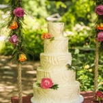 Buttercream Wedding Cake on a Summer Floral Garden Swing | Lovely and Light | See More! https://heyweddinglady.com/southern-garden-wedding-brunch-in-jewel-tones-from-lovely-and-light/