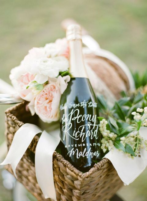 Romantic Picnic Basket with Calligraphy Champagne Bottle | KT Merry Photography | See More! https://heyweddinglady.com/elegant-country-manor-wedding-inspiration-in-marble-and-blush/