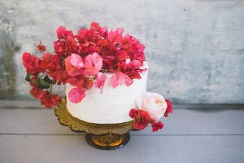 Crimson Bougainvillea Wedding Cake | Anna Delores Photography | See More! https://heyweddinglady.com/driftwood-and-crimson-coastal-wedding-inspiration/