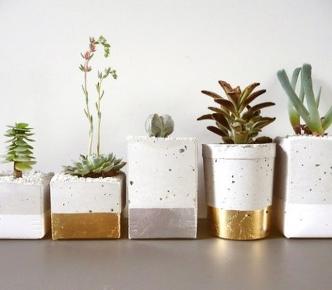 Gold Dipped Cement Succulent Planters | Oh, Laszlo! | See More! http://heyweddinglady.com/natural-earthy-wedding-inspiration-in-terra-cotta-gold-green/
