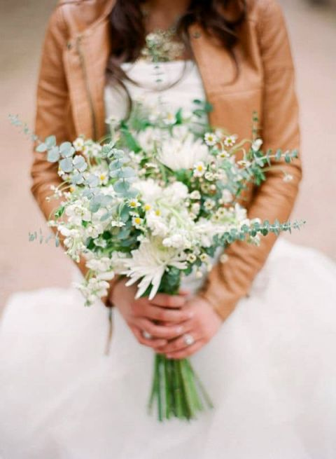 Leather Jacket over a Wedding Dress | Cassidy Brooke Photography | See More! https://heyweddinglady.com/natural-earthy-wedding-inspiration-in-terra-cotta-gold-green/