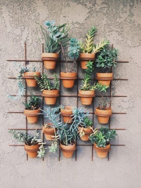 Living Garden Wall of Terra Cotta Pots | Happy Mundane Photography | See More! https://heyweddinglady.com/natural-earthy-wedding-inspiration-in-terra-cotta-gold-green/
