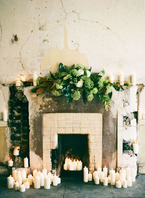 Marble Mantelpiece Draped in Candles and Greenery for a Romantic Wedding Ceremony | Katie Stoops Photography | See More! https://heyweddinglady.com/cashmere-and-champagne-warm-neutral-wedding-inspiration/