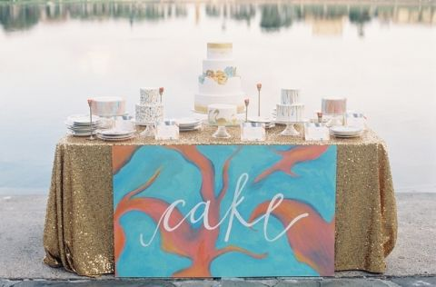 Vibrant Watercolor Wedding Cake Table in Glittering Gold, Aqua, and Burnt Orange | Kat Braman Photography | See More! https://heyweddinglady.com/modern-art-nouveau-wedding-inspiration-glittering-gold-orange-blue/