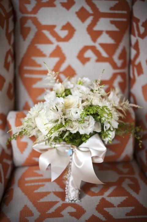 Green and White Bridal Bouquet on a Vibrant Orange Print | BRC Photography | See More! https://heyweddinglady.com/impossibly-chic-modern-art-inspired-wedding/