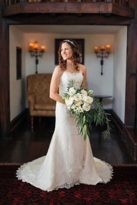 A Lush White and Green Cascade Bouquet with a Classic Sweetheart Wedding Dress | Vitaly M Photography | See More! https://heyweddinglady.com/historic-villa-wedding-in-southern-california/