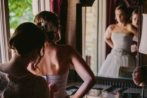 The Beautiful Bride Getting Ready | PhotoHouse Films | See More! https://heyweddinglady.com/ethereal-texas-garden-wedding-in-gray-pink-and-gold/