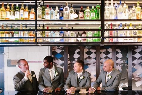Groom and Groomsmen Getting Ready - at the Bar, of course! | Hilary Cam Photography | See More! http://heyweddinglady.com/midsummer-nights-dream-wedding-in-a-secret-garden/