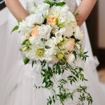 White and Peach Cascade Bouquet for a Romantic Secret Garden Wedding | Hilary Cam Photography | See More! https://heyweddinglady.com/midsummer-nights-dream-wedding-in-a-secret-garden/
