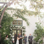 Romantic Villa San Juan Capistrano Wedding Ceremony under an Arch of Greenery and White Flowers | Vitaly M Photography | See More! https://heyweddinglady.com/historic-villa-wedding-in-southern-california/