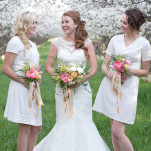Bridesmaids in Crisp White Shift Dresses with Pastel Citrus Bouquets | Natalie Felt Photography | See More! https://heyweddinglady.com/blooming-orchard-wedding-shoot-in-pastel-citrus-shades/