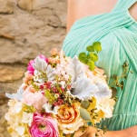 Bridesmaids in Aqua with Coral and Peach Bouquets | D. Park Photography | See More! https://heyweddinglady.com/coral-peach-and-aqua-wedding-by-the-sea/
