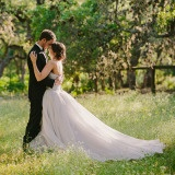 Ethereally Romantic Texas Garden Wedding with a Silver Ball Gown | PhotoHouse Films | See More! https://heyweddinglady.com/ethereal-texas-garden-wedding-in-gray-pink-and-gold/