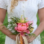 Coral Peony Bouquet with Trailing Ribbons | Natalie Felt Photography | See More! https://heyweddinglady.com/blooming-orchard-wedding-shoot-in-pastel-citrus-shades/