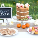 A Romantic and Rustic Dessert Display with a Naked Wedding Cake, Pastel Macarons, and a Chalkboard Sign | Natalie Felt Photography | See More! https://heyweddinglady.com/blooming-orchard-wedding-shoot-in-pastel-citrus-shades/