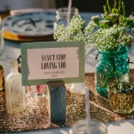 Tables Named After Their Favorite Love Songs | PhotoHouse Films | See More! https://heyweddinglady.com/ethereal-texas-garden-wedding-in-gray-pink-and-gold/