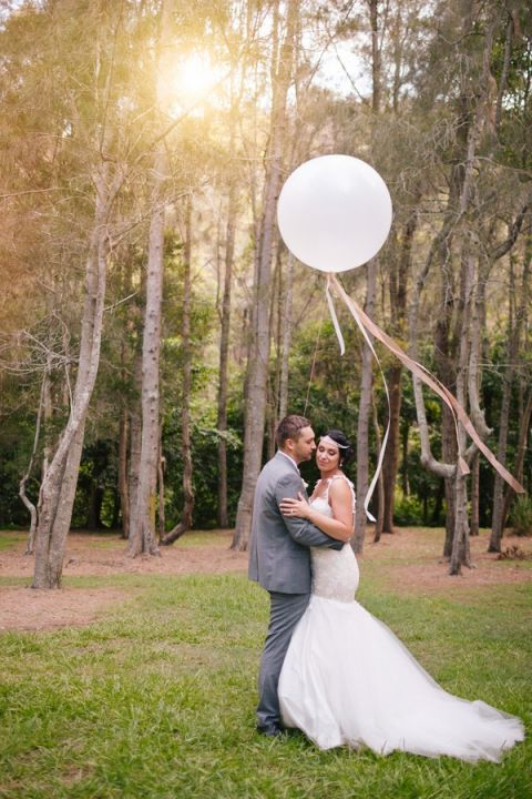 Stunning Romantic Garden Wedding with Giant Balloons | Hilary Cam Photography | See More! http://heyweddinglady.com/midsummer-nights-dream-wedding-in-a-secret-garden/