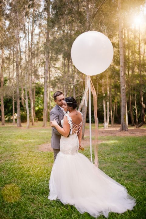 Dramatic, Glamorous Wedding Dress with a Pearl Draped Back | Hilary Cam Photography | See More! http://heyweddinglady.com/midsummer-nights-dream-wedding-in-a-secret-garden/