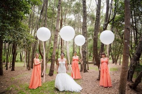 Midsummer Nights Dream Wedding with Peach Goddess Gowns and a Stunning Mermaid Wedding Dress - not to mention giant balloons! | Hilary Cam Photography | See More! http://heyweddinglady.com/midsummer-nights-dream-wedding-in-a-secret-garden/