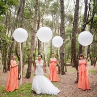 Midsummer Nights Dream Wedding with Peach Goddess Gowns and a Stunning Mermaid Wedding Dress - not to mention giant balloons! | Hilary Cam Photography | See More! https://heyweddinglady.com/midsummer-nights-dream-wedding-in-a-secret-garden/