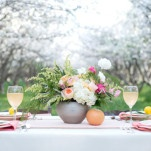 A Sweet and Simple Head Table set in a Blooming Orchard | Anna Gleave Photography | See More! https://heyweddinglady.com/blooming-orchard-wedding-shoot-in-pastel-citrus-shades/