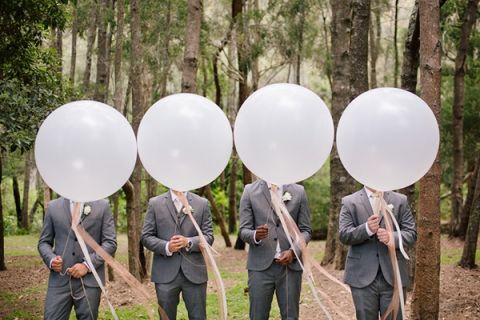 Groomsmen in Gray with Giant Balloons | Hilary Cam Photography | See More! http://heyweddinglady.com/midsummer-nights-dream-wedding-in-a-secret-garden/