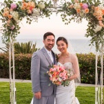 A Tropical Inspired Peach and Coral Floral Wedding Arch | D. Park Photography | See More! https://heyweddinglady.com/coral-peach-and-aqua-wedding-by-the-sea/