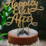 Happily Ever After Gold Cake Topper | PhotoHouse Films | See More! https://heyweddinglady.com/ethereal-texas-garden-wedding-in-gray-pink-and-gold/