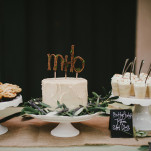 Romantic Rustic Wedding Cake and Dessert Display with a Handmade Monogram Cake Topper | Vitaly M Photography | See More! https://heyweddinglady.com/historic-villa-wedding-in-southern-california/