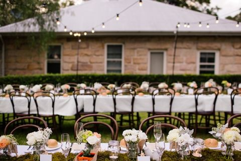 Cane Chairs, Peach Flowers, and Moss Runners for a Midsummer Nights Dream Wedding in a Secret Garden | Hilary Cam Photography | See More! http://heyweddinglady.com/midsummer-nights-dream-wedding-in-a-secret-garden/
