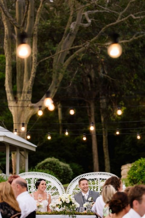 Romantic Garden Wedding Reception with Bistro Lighting | Hilary Cam Photography | See More! http://heyweddinglady.com/midsummer-nights-dream-wedding-in-a-secret-garden/