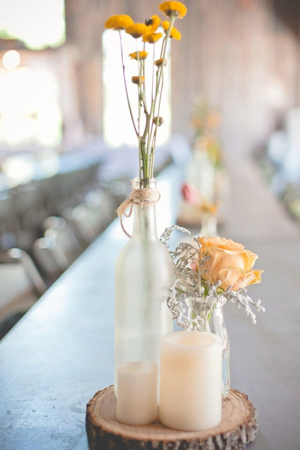 Simple Woodsy Wedding Centerpieces In Gray And Creamy Orange Dust