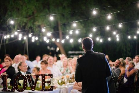 LOVE Marquee Letters and Bistro Lighting | Hilary Cam Photography | See More! http://heyweddinglady.com/midsummer-nights-dream-wedding-in-a-secret-garden/
